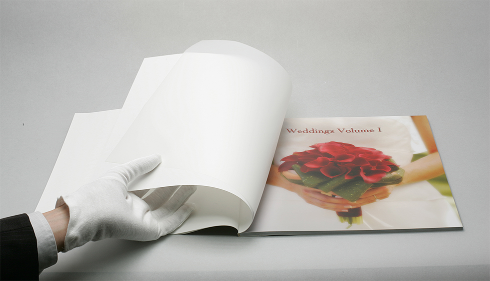 AsukaBook Book Bound Soft Cover Photo Book comes with a vellum sheet inside the cover
