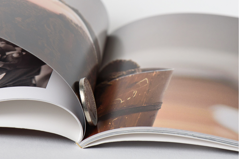 AsukaBook Book Bound Soft Cover Photo Book page thickness compared to a nickel