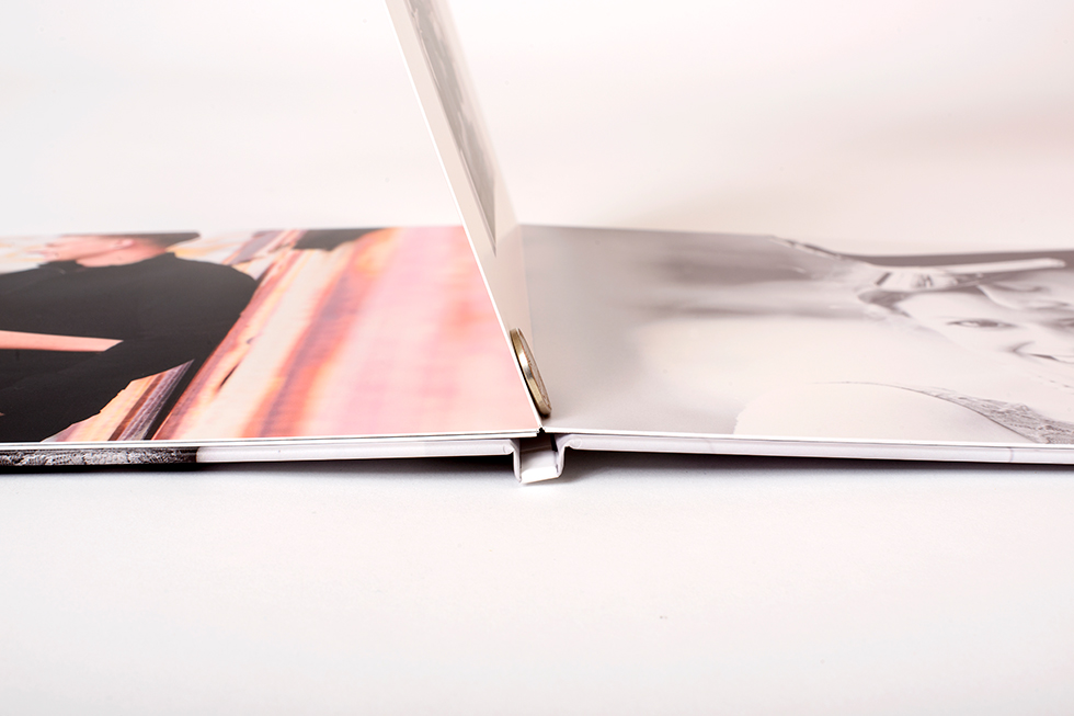 AsukaBook Curve Photo Book page thickness compared to a nickel